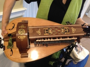 Leah Trent holds her beautiful vielle/hurdy-gurdy (close-up)