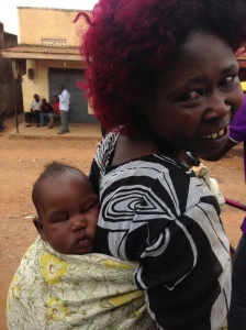 A Muganda woman from Busibo carries her sleeping son. May he dream big dreams!